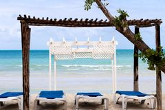Wooden white gazebo by the beach royalty free stock photography