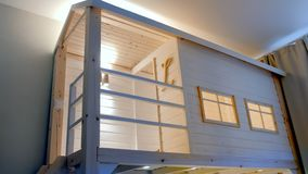 Wooden white house in kids room with windows and bed inside. Wooden white house in kids room with windows and bed inside stock video