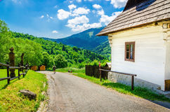 Wooden white hut in village, Eastern Europe. Wooden white hut in beautiful Vlkolinec traditional village in Slovakia, Eastern Europe Royalty Free Stock Photo