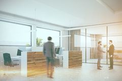 Wooden and white office corner, people. Modern office corner with a concrete floor, wooden columns and computer tables. Business people. 3d rendering mock up Royalty Free Stock Images