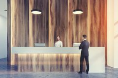 Wooden and white reception close up toned Royalty Free Stock Photo