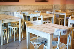 Wooden white tables in a retro cafe Royalty Free Stock Photography