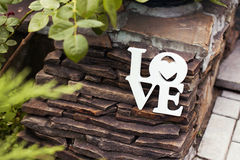 Wooden white wedding decoration with word Love Royalty Free Stock Photo