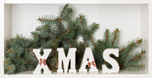 Wooden white XMAS letters on a white background with Packed gift Royalty Free Stock Photo