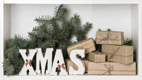 Wooden white XMAS letters on a white background with Packed gift Stock Photography