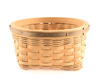 Wooden wicker basket isolated over white Royalty Free Stock Image