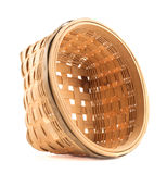 Wooden wicker basket isolated over white Royalty Free Stock Photography