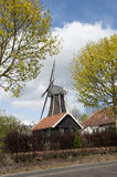 Wooden wind mill in a farm scenery Stock Photography