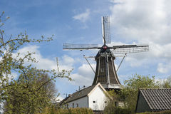 Wooden wind mill in urban setting Royalty Free Stock Images