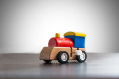 Wooden wind-up train toy on white background royalty free stock image