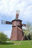 Wooden Windmill. Ancient red wooden windmill in Western Finland Stock Image