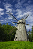 Wooden windmill. A vertical image of a large old windmill made of wood, typical for Northern Europe Stock Photos