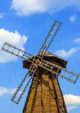Wooden windmill against the sky Stock Photo