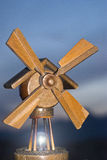 Wooden windmill. concept of energy. Old wooden model of a windmill that turns on a light bulb.. concept of energy royalty free stock image