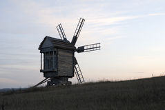 Wooden windmill in evening Royalty Free Stock Images