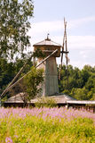 Wooden windmill. In a field near the forest royalty free stock image