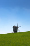 Wooden windmill in the field. Stock Photography