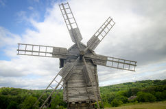 Wooden windmill in the forest Royalty Free Stock Photo