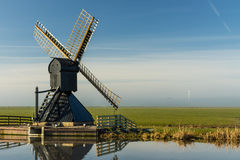 Wooden windmill at frisian landscape Royalty Free Stock Photography