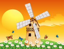 A wooden windmill at the garden Royalty Free Stock Images