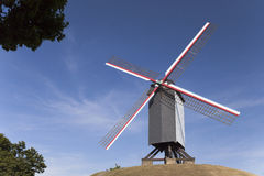 Wooden windmill on the hill in Bruges Royalty Free Stock Photo