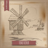 Wooden windmill, landscape and wheat vector sketch on wintage background. Stock Photography
