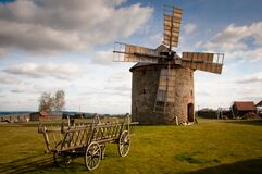 Wooden Windmill Near Wooden Carriage during Daytime Royalty Free Stock Photography