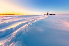 Free Wooden Windmill On Background Winter Sunrise. Dudutki Village, Belarus Royalty Free Stock Photo - 148449785