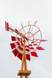 Wooden windmill. Red and white wooden windmill Stock Images