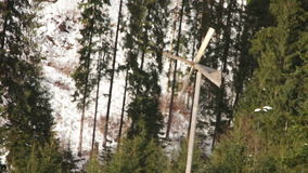 Wooden windmill spinning in the wind in winter stock video footage