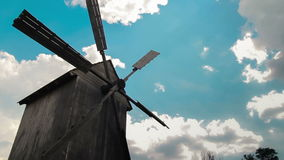Wooden windmill with time lapse clouds in the sky stock video footage
