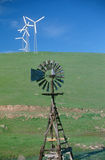 Wooden windmill and wind turbines, SD royalty free stock images