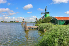 Wooden windmills in dutch village. royalty free stock image