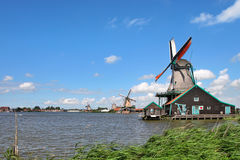 Wooden windmills in dutch village. royalty free stock photography