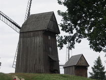 Wooden windmills, Poland Dziekanowice. Two wooden windmills at ethnographic park Royalty Free Stock Image