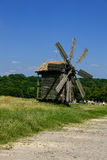 Wooden windmills in the village Royalty Free Stock Images
