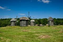 Wooden windmills in the village Stock Image