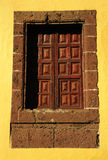 Wooden window. Old window on yellow wall Royalty Free Stock Photography