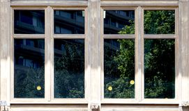 Wooden window architecture with green reflection in the glass. In Taiwan Stock Photos