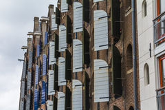 Wooden window blinds on typical Amsterdam houses Royalty Free Stock Photo