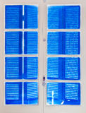 Wooden window with blue shutters closed, Royalty Free Stock Photography