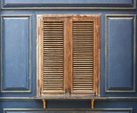 Wooden window and blue wall Stock Photography
