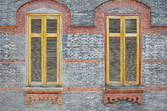Wooden window on brick wall Stock Photos