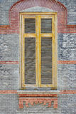 Wooden window on brick wall Stock Photo