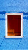 Wooden Window in Burano on blue color wall Stock Photography