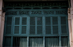Wooden window classic house in ancient style Phuket in Thailand Stock Photos