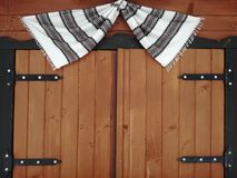 Wooden window with a cloth with black and white stripes Royalty Free Stock Images