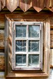 Wooden window with cobwebs behind glass. Traditional cottage, Poland royalty free stock photography