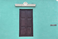Wooden window of a colonial house in Guantanamo, Cuba. Detail of a facade of a colonial house in Guantanamo, Cuba stock photography