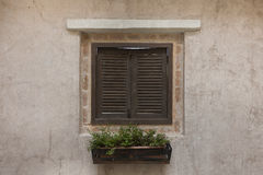 Wooden Window  on Concrete Wall. Royalty Free Stock Photography